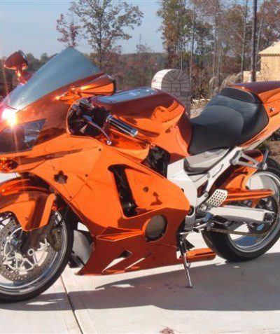 Chrome tinted orange street bike